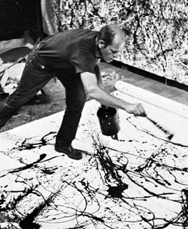 Jackson Pollock painting in his studio on Long Island, New York, 1950.